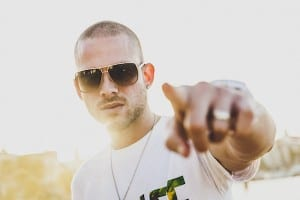Collie Buddz points his finger at the camera before his set at Shoreline Jam at the Queen Mary, August 31,2014 in Long Beach, CA.
